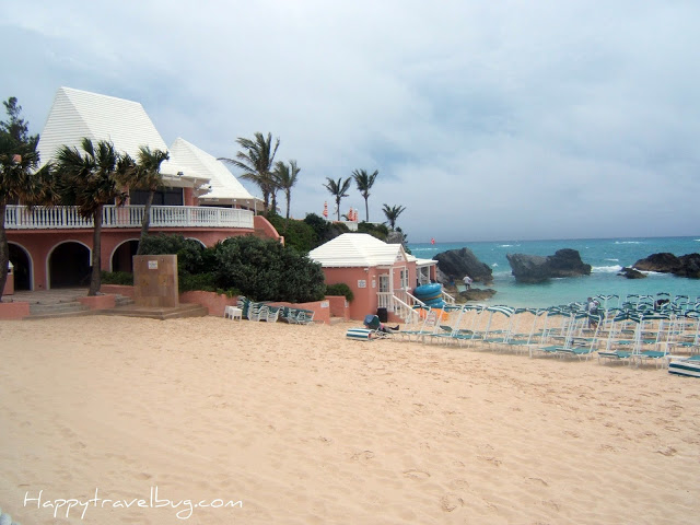 Pink Bermuda Sand with a pink building and lounge chairs