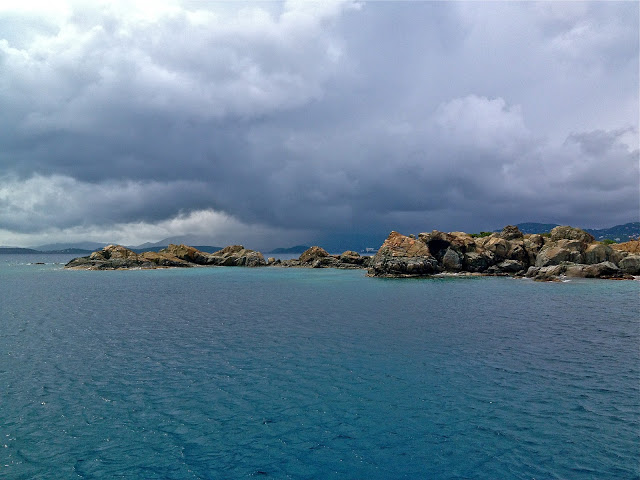 Rain clouds over the ocean and rocks