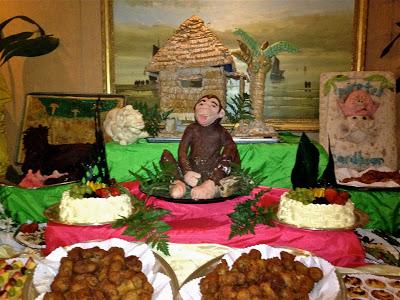 dessert buffet with monkey and hut sculpture