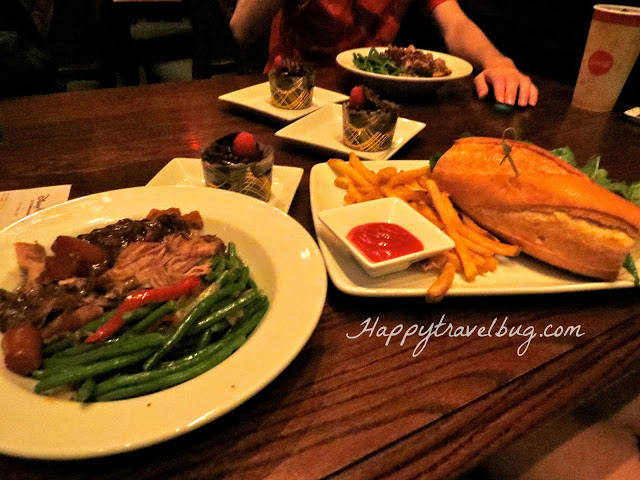 Our lunch at Be Our Guest in Disney World: pork, green beans, chocolate cupcakes