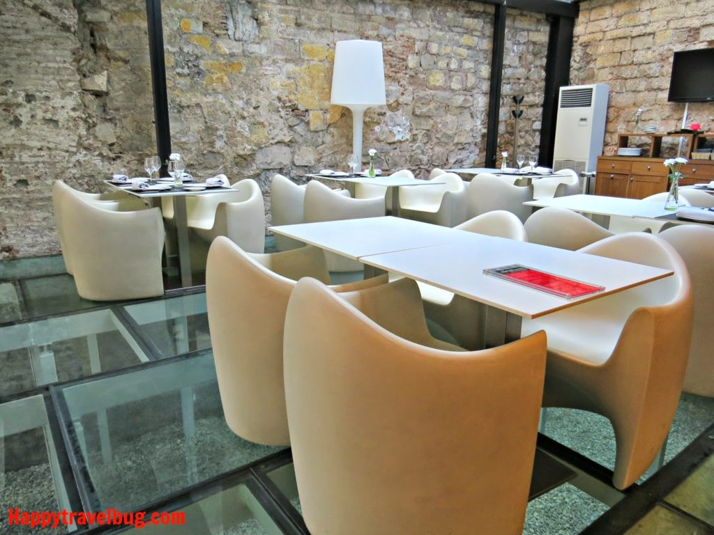 Clear glass floors with white modern chairs in a restaurant