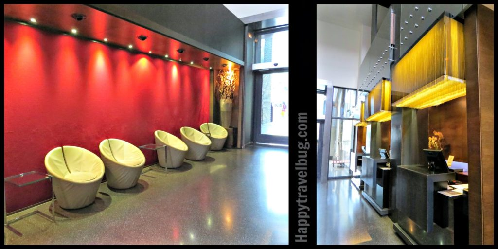 hotel lobby with red wall and modern white chairs