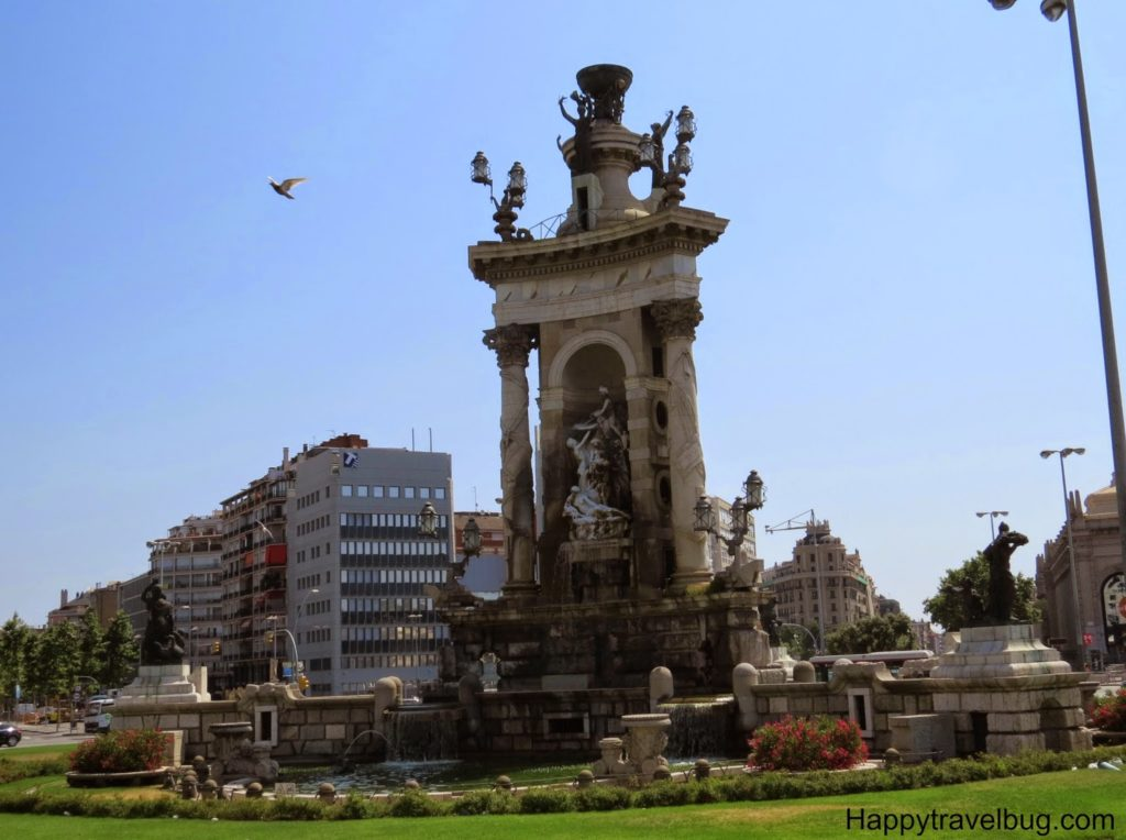 Statue in Barcelona, Spain with a bird flying