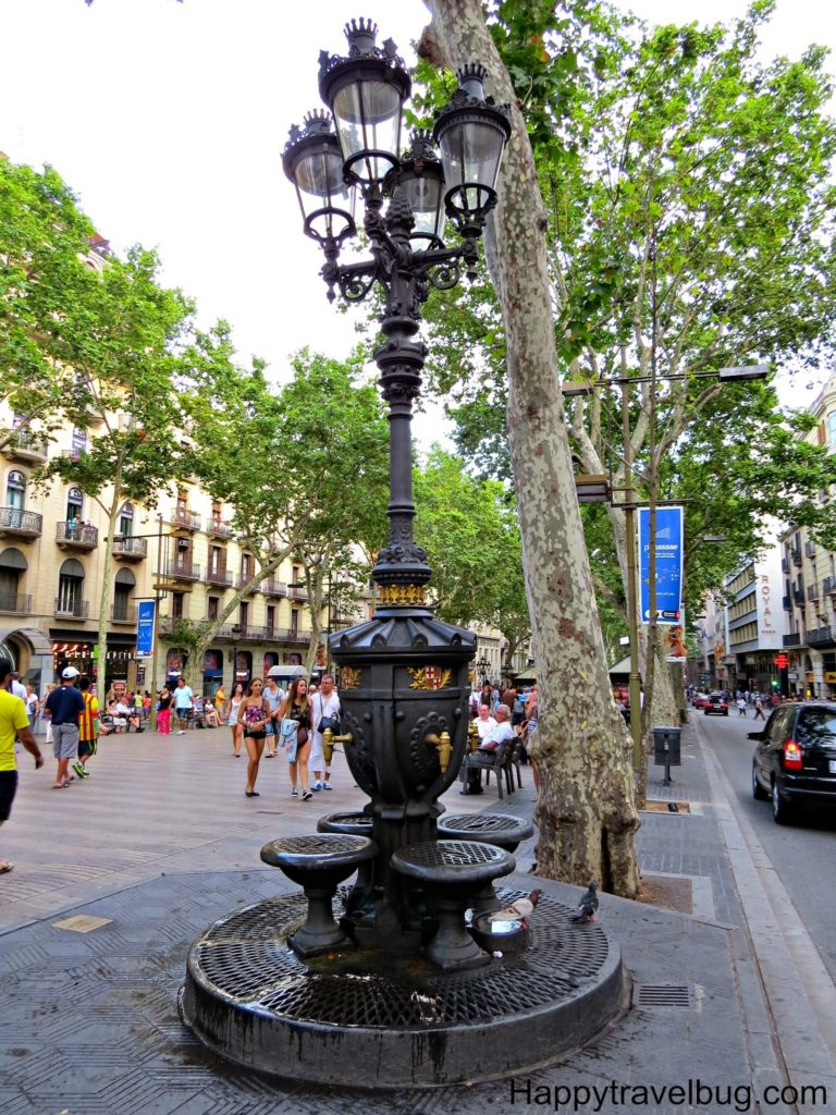 Street light and water fountain all in one on la Rambla in Barcelona, Spain