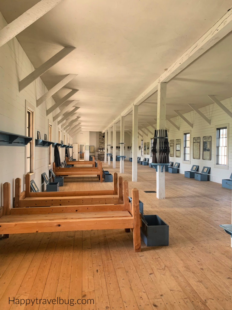 Inside the calvary barracks with beds all lined up