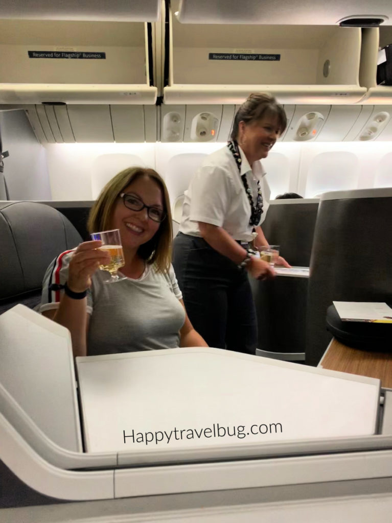 Woman drinking champagne on an airplane