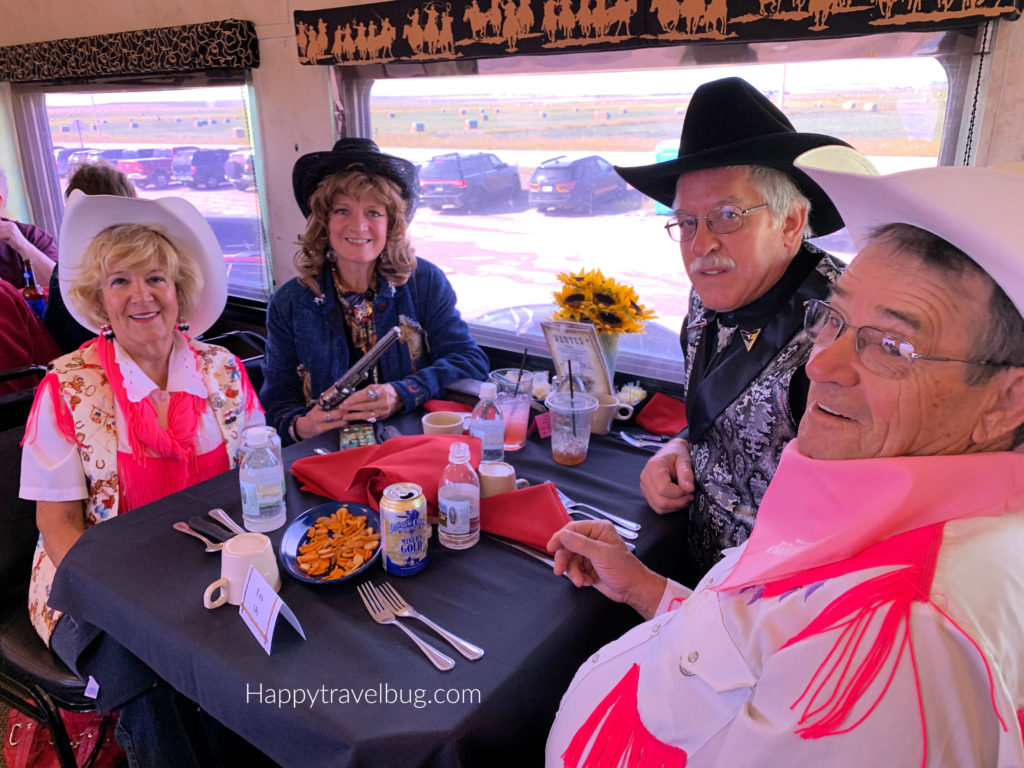 two cowboy and cowgirl dressed couples