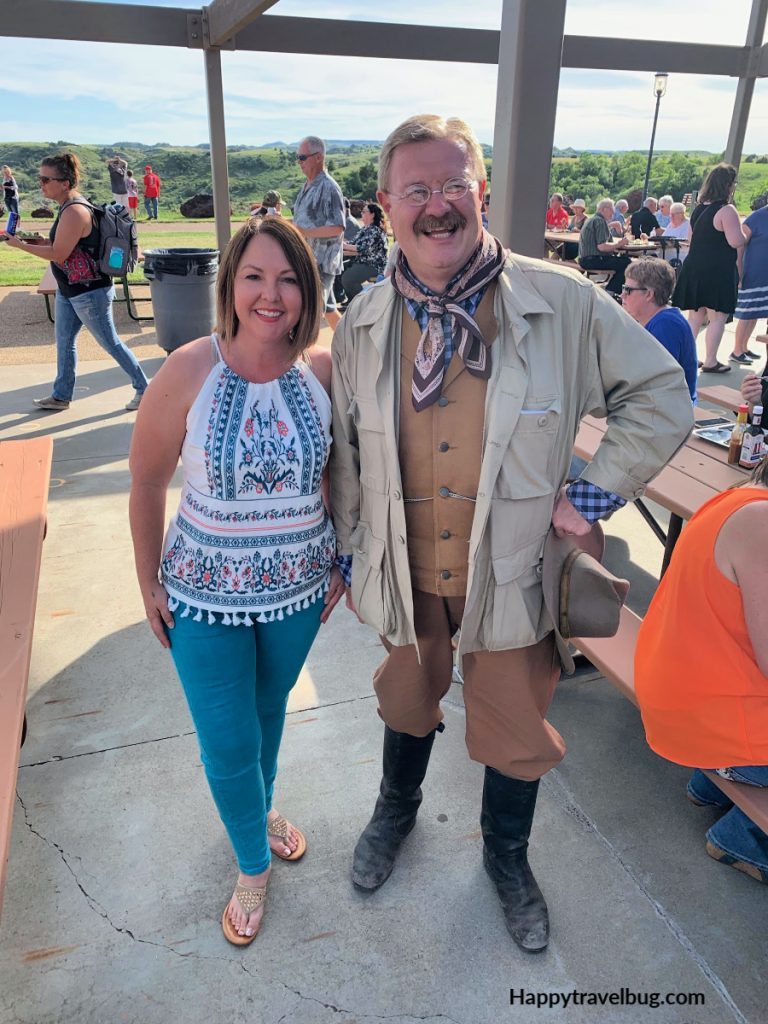 A woman with a Teddy Roosevelt impersonator
