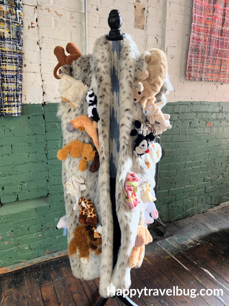 FAke furr coat with stuffed animals on it