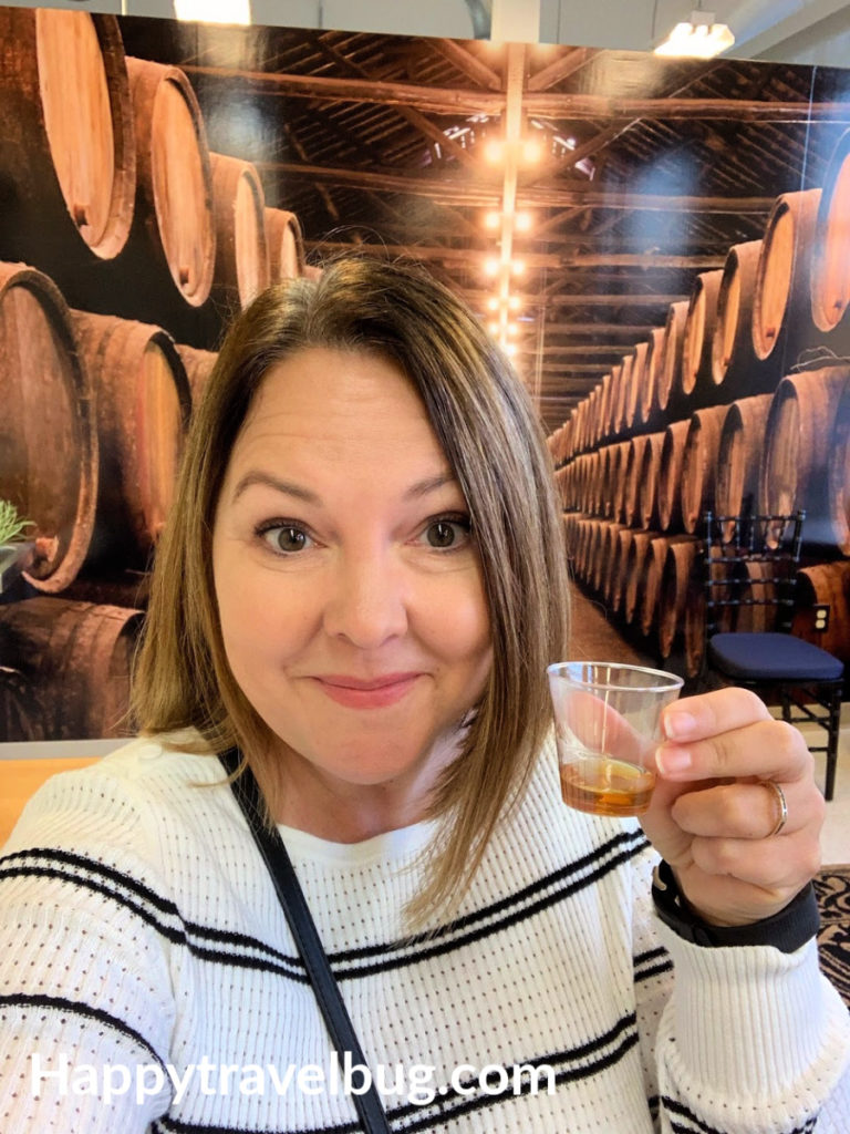 Woman drinking bourbon whiskey sample